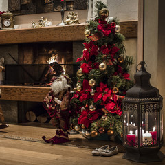 Christmas tree near fireplace with decorations