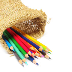 Colour pencils in a bag isolated on white background