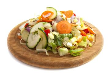 Sliced vegetables on wood