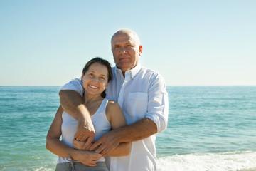 man and   woman  walking  at sea