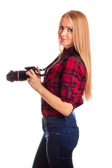 Attractive woman photographer at work with DSLR isolated over wh