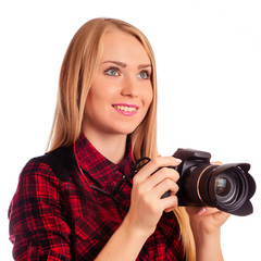 Attractive female photographer holding a professional camera - i