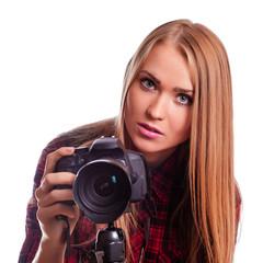 Glamour female photographer taking images - isolated on white
