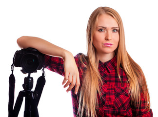 Attractive Woman photographer at work with DSLR isolated on whit