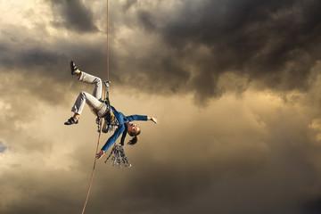 Climber looses her balance.