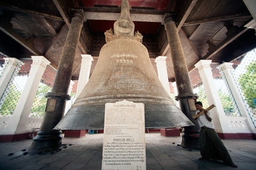 Man hitting the Mingun Largest bell in the World,Myanmar.