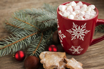 Winter ornament cup surrounded by cookies