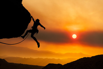 Climber grips the edge.