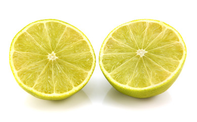 Fresh lime fruit cut in half showing cross section