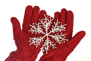 Hands in red gloves with snowflakes