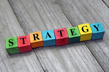concept of strategy word on wooden colorful cubes