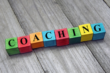 concept of coaching word on wooden colorful cubes