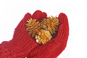 Gold cones in the hands in red gloves