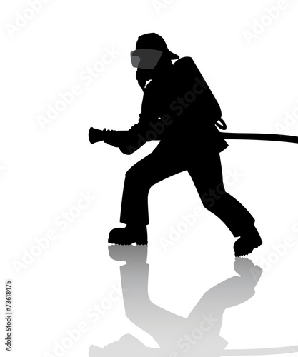 Silhouette of a firefighter in action - 73618475