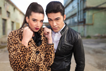 Young fashion couple posing near old factories.
