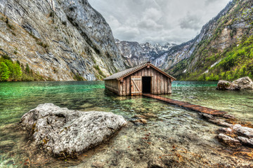 Boat dock hangar on Obersee mountain lake in Alps