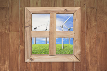 see wind power station through wooden window