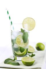 Lemonade in glass on napkin on bright background
