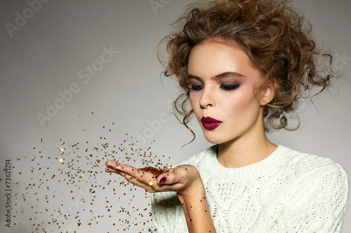 canvas print picture Beautiful girl with evening makeup blow gold sequins
