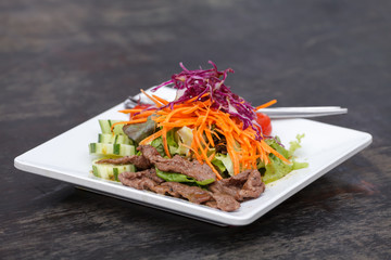 Asian Sliced Beef Salad with red cabbage and Carrots