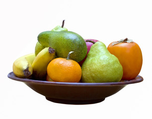 Different colorful fruits on the plate isolated
