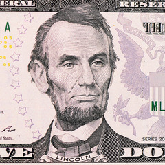 The face Lincoln the dollar bill