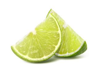 Two quarter lime pieces isolated on white