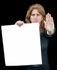 Serious woman gesturing to stop with white banner