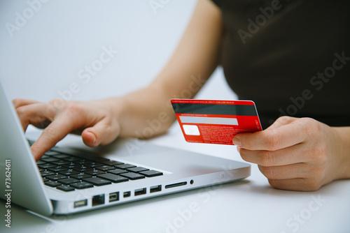 Leinwandbild Motiv Paying with credit card online