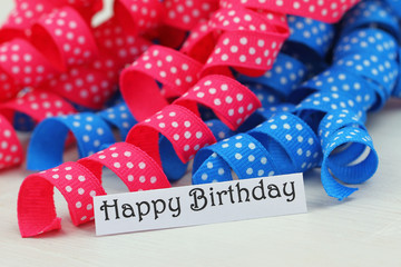 Happy birthday card with pink and blue ribbon