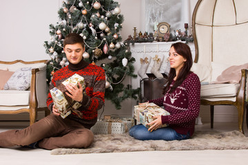 Happy young couple celebrating Christmas