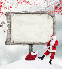 Santa Claus with empty wooden sign