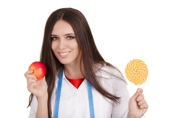 Nutritionist Holding an Apple and a Big Candy