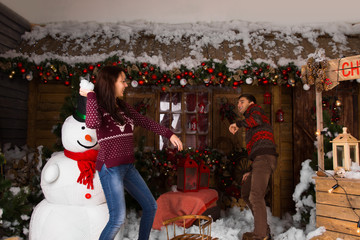 Woman Throwing Cotton Snow to a Guy While Playing
