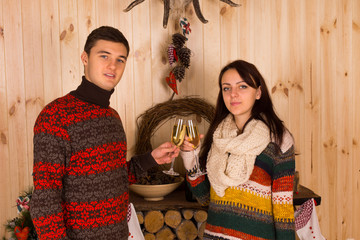 Couple Tossing Glasses of Wine Inside the House
