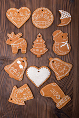 Gingerbread cookies on wooden background