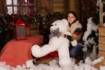 Young Woman Embracing Big White Bear Doll