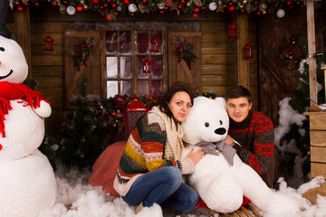 Young Couple Hugging White Winter Bear Doll