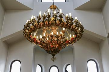 Antique pending lamp in church