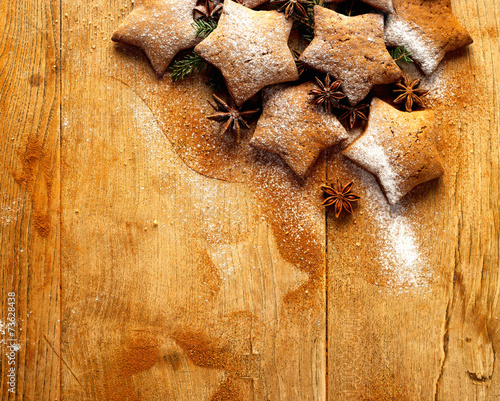 Christmas gingerbread stars on wooden background - 73628438