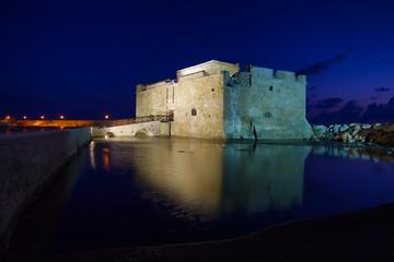 Illuminated Paphos Castle at night, Cyprus.