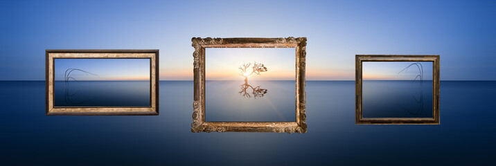 Conceptual image of landscape pictures hanging in frames above c
