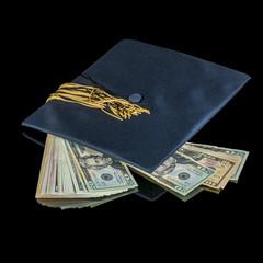 Many dollars along with a graduation cap