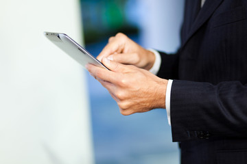 Businessman using his digital tablet