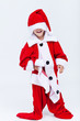 Happy santa helper trying on very large christmas costume