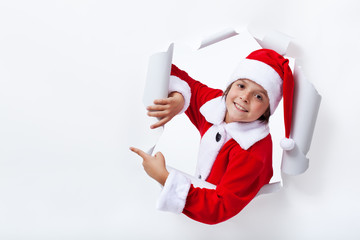 Happy Santa Claus costume boy pointing to copy space
