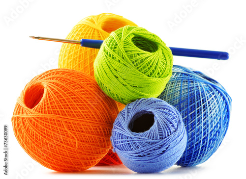 Leinwanddruck Bild Colorful yarn for crocheting and hook isolated on white