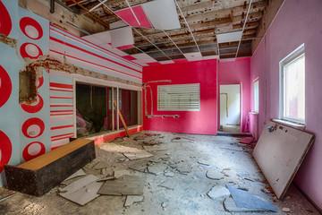 Demolished room with pink walls