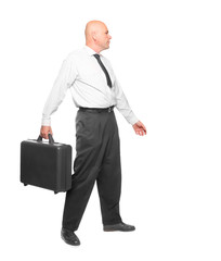 Successful businessman with suitcase going to work.