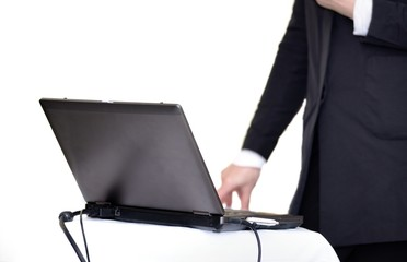 Laptop on table with hand